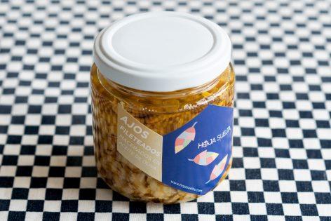 Ajos fileteados y macerados en aceite de oliva ~tarro mediano